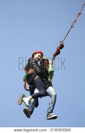 Belarus Gomel May 06 2017.Jumping with a rope.Flight down on the rope.Engage in ropejumping.Dangerous hobbies.Crazy Love Story