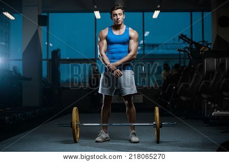 sexy strong bodybuilder athletic fitness man pumping up muscles workout bodybuilding concept background - muscular bodybuilder handsome men doing fitness exercises in gym naked torso