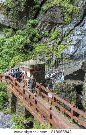 Paro, Bhutan - September 18, 2016: Tourists On The Way Back From Taktshang Palphug Monastery (the Ti