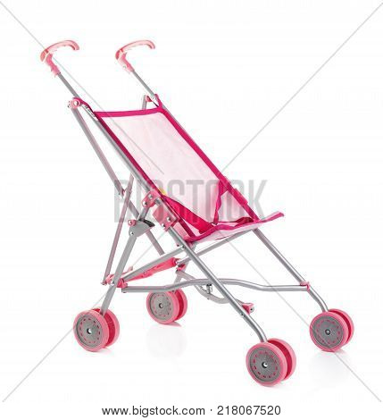 Little pink baby carriage or doll stroller isolated on white.