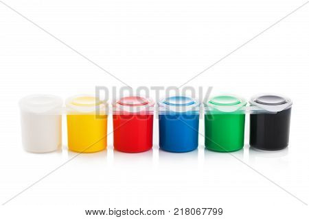 Large Set Of Gouache Paint Cans In A Row. Colorful Paints Isolated On White