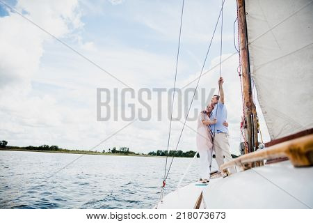 Retired marriage sailing on the lake. Summer tourists. Active retirement.