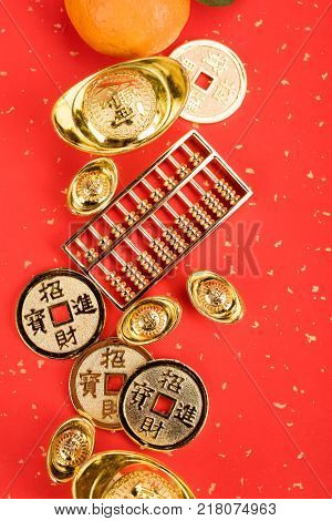 Chinese new year ornament--gold ingot,orange,golden coin and golden abacus,Chinese calligraphy Translation:god bless for new year
