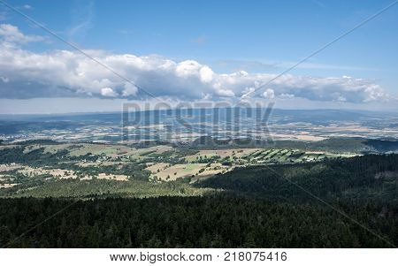 beautiful landscape of moravian - bohemian borders with countryside Orlicke hory mountain range and blue sky with clouds from Klepac hill in Kralcky Sneznik mountain range during nice summer day