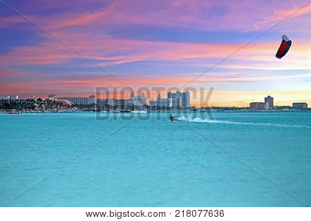 Kite surfing at Palm Beach at Aruba island in the caribbean sea at sunset