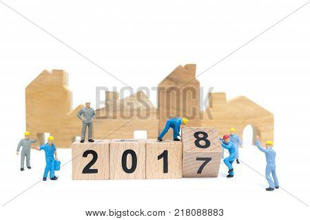 Miniature people : Worker team building wooden block number 2018 isolated on white background