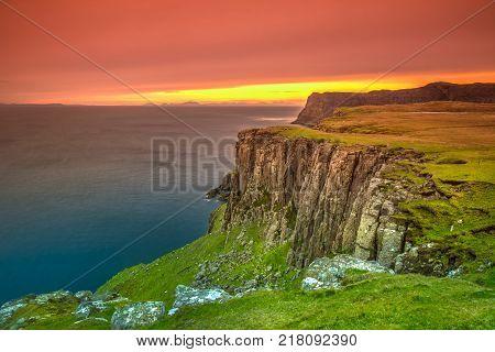 Waterstein Head, sunset walk along dramatic coastline, visiting the top of three great coastal cliffs. Duirinish coast, Isle of Skye, Highlands, Scotland, UK
