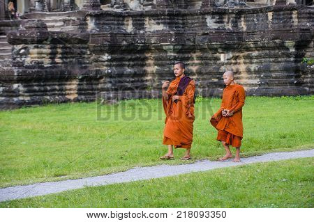 Siem Reap Cambodia - Oct 17 : Budhist Monks At The Angkor Wat Temple In Siem Reap Cambodia On Octobe