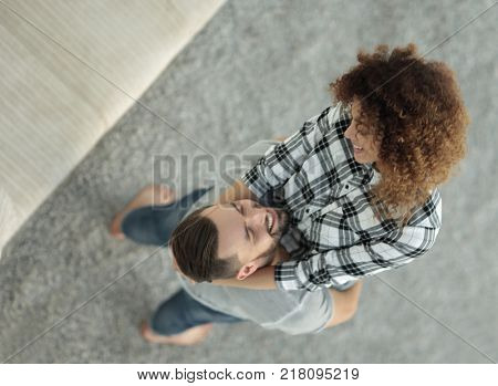 happy young couple exulting in new apartment