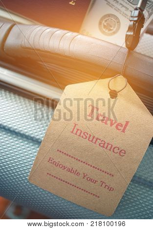 Travel Insurance tag on suitcase near numeric combination lock passport and US Dollar. Travel Insurance is intended cover medical expensescover lost luggage flight cancellation or accident