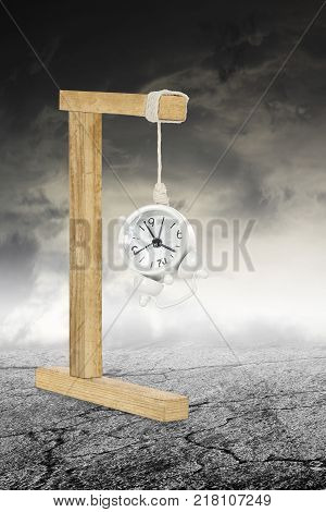 alarm clock hanging on gallows abstract time concept