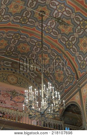 Bucharest Romania October 10 2017 : Large decorated chandelier hanging on the ceiling in the synagogue Coral in Bucharest city in Romania