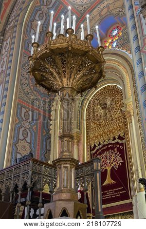 Bucharest Romania October 10 2017 : A large ornately decorated lamp stands on the floor in the synagogue Coral in Bucharest city in Romania