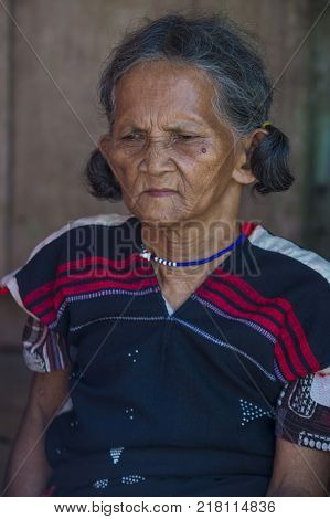 QUANG NAM VIETNAM - OCT 07 : Portrait of a woman from the Cotu Minority in Quang Nam Vietnam on October 07 2017. The Cotu minority mostly live in central Vietnam and eastern Laos