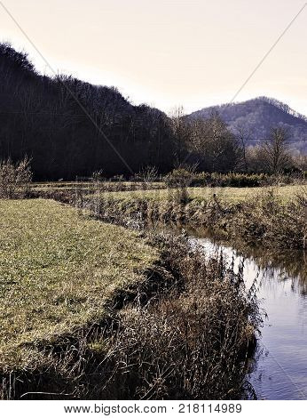 A Field with a Creek running through it. This is the North Fork of The Clinch River in Duffield VA