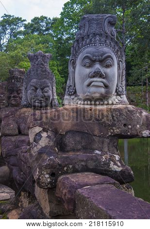 SIEM REAP CAMBODIA - OCT 15 : Statues at the South Gate of Angkor Thom Siem Reap Cambodia on October 15 2017 Angkor Thom was the last and capital city of the Khmer empire.
