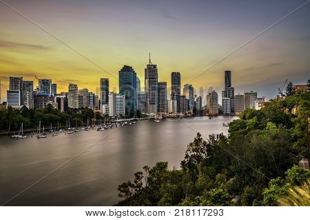 Sunset skyline of Brisbane city and Brisbane river  from Kangaroo Point Cliffs, Queensland, Australia. Long exposure.