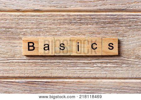 BASICS word written on wood block. BASICS text on table concept.