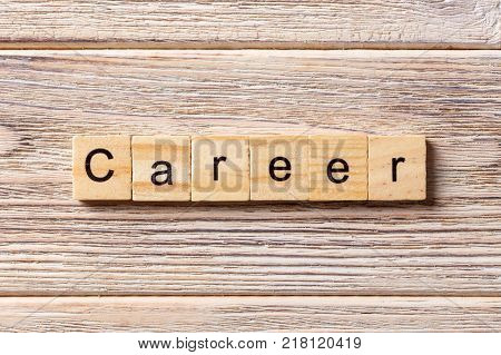 Career word written on wood block. Career text on table concept.