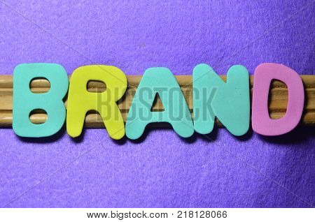 WORD BRAND ON AN  ABSTRACT COLORED BACKGROUND