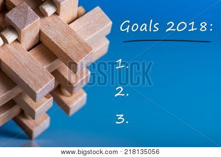 Goals 2018 memo about targets, goal, dreams and New Year's promises for the next year. Brain teaser a symbol of interesting and complex tasks.