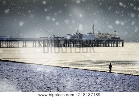 Brighton pier and seafront snowy scene on Sussex coast