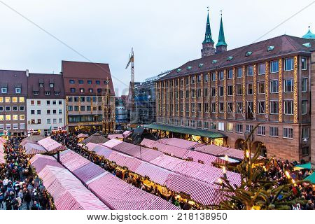 NUREMBERG - GERMANY - DECEMBER 2 2017: view of the Christkindlesmarkt a Christmas market in the Hauptmarkt the central square in Nuremberg's old town Germany.