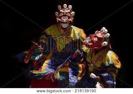 Buddhist monks perform the ancient Cham Dance, Mask Dance Red Mahakala, Zanskar, Northern India.