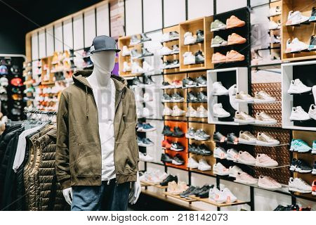 Mannequin Dressed In Male Man Casual Clothes In Store Of Shopping Center On Background Of Shoes.