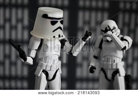 Humorous image of Star Wars Imperial Stormtroopers, one has a replacement helmet / bucket while the other face palms - Hasbro Black Series Action Figures