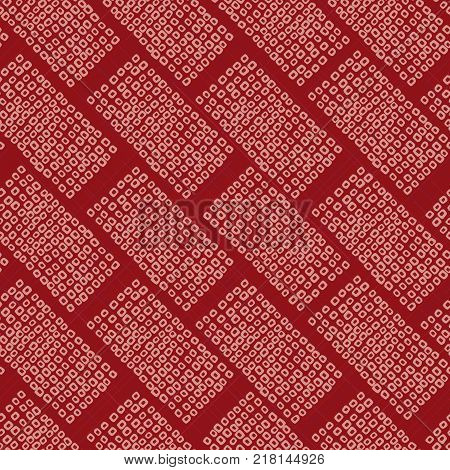 Seamless pattern. Japanese Shibori ornament. Asian. Inclined motif. Grey background. Classic japanese dyeing technique. Plain backdrop for wallpaper, web page background or handicraft.