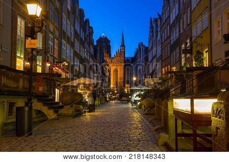 GDANSK, POLAND - DECEMBER 8, 2017: Mariacka street in the old town of Gdansk at night, Poland. Gdansk is the historical capital of Polish Pomerania with gothic architecture.