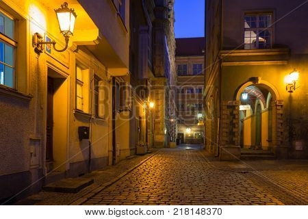 GDANSK, POLAND - DECEMBER 8, 2017: Architecture of the old town of Gdansk at night, Poland. Gdansk is the historical capital of Polish Pomerania with gothic architecture.