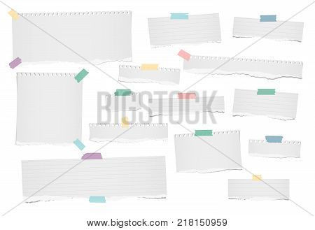 White ripped blank, lined note, notebook paper strips for text or message stuck with colorful adhesive, sticky tape on white background