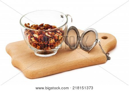 pile of fruit tea black tea green tea herbal tea in glass cup on the wooden board