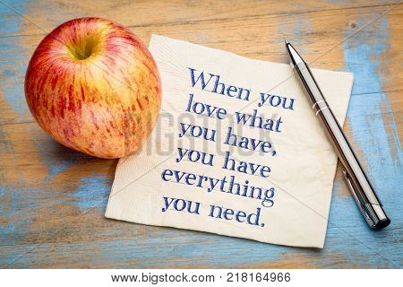 When you love what you have, you have eveything you need - inspiraitonal  handwriting on a napkin with a fresh apple
