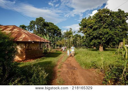 KOLONYI, UGANDA - NOVEMBER 09, 2017: Charity and relief workers with there kids walking around the local villages of Mbale in Uganda. Enjoying a break of the charity work.