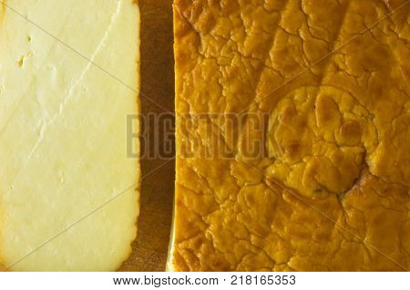cut head of traditional Adygei cheese handmade on wooden Board