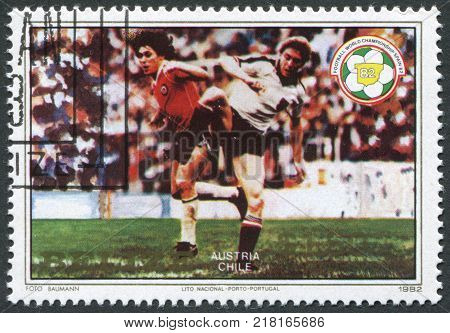 BELIZE-CIRCA 1982: A stamp printed in the Belize is dedicated to FIFA World Cup 1982 in Spain shows a match between Austria - Chile circa 1982