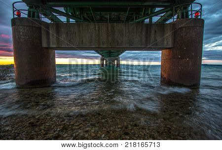 Under The Mackinaw Bridge. View of underneath the Mackinac Bridge in Michigan. The Mackinaw Bridge is one of the longest suspension bridges in the world.