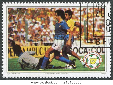 BELIZE-CIRCA 1982: A stamp printed in the Belize is dedicated to FIFA World Cup 1982 in Spain shows a match between Italy - Brazil circa 1982