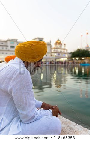 AMRITSAR INDIA - MARCH 20 2016: Black and white picture of Indian sikh people on movement at Sri Harmandir Sahib known as Golden Temple located in Amritsar Punjab India.