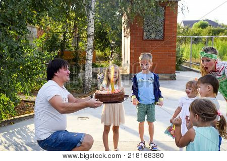 village Poltavskaja, Russia - September 8, 2017: Leisure of preschool children. Animators at a children's party. Acting and developing games for children