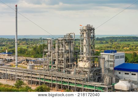 Pipeline and refinery tower stack of petrochemical plant.