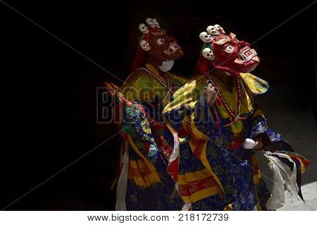 Buddhist monks perform the ritual Cham Dance in a Tibetan monastery for the feast, Masks and costumes of the Red Mahakala.