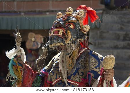 Performing the ritual Dance of Masks, Cham Dance in the Buddhist monastery of Northern India.