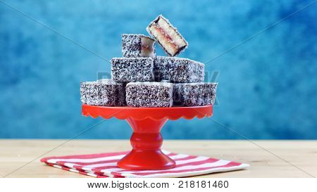 Iconic traditional Australian party food, Lamington cake, on a red, white and blue background.