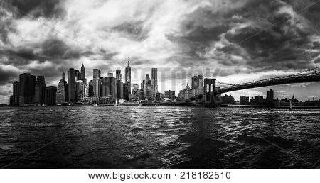 Manhattan and Brooklyn bridge over East river in black and white