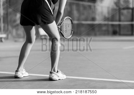 Woman playing tennis and waiting for the service. black and white tennis sport girl. tennis racket. tennis player