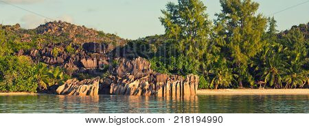 Tropical beach at Curieuse island Seychelles. Lohg wide banner
